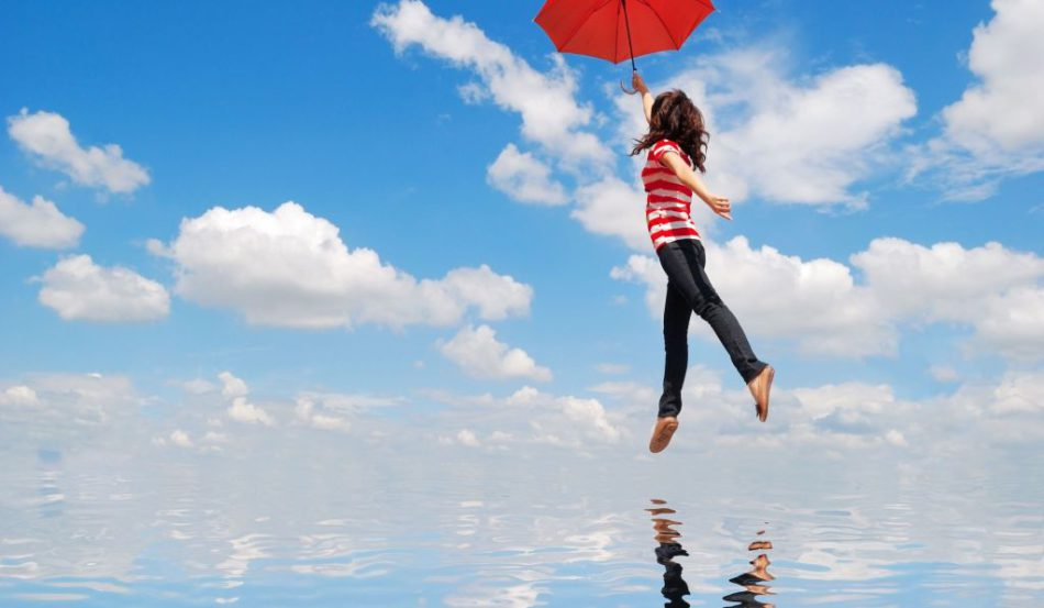 woman flying with red umbrella