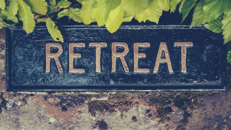 Image with the word retreat printed on a sign.