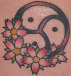 My tattoo of the BDSM symbol and cherry blossom - this is symbol of my submission to my Husband.