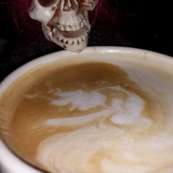Skelly sipping Rebel's cappucino