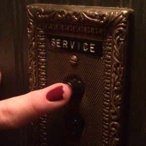 Service button in an old-fashioned lift.