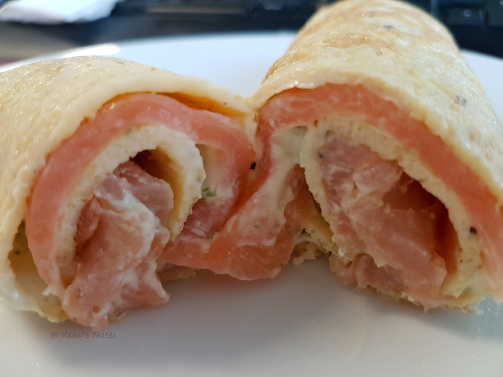 An omelet wrap with smoked salmon and cream cheese.