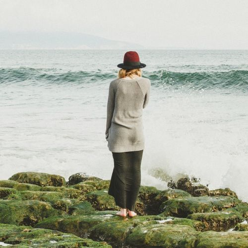 Woman on the rocks at the sea