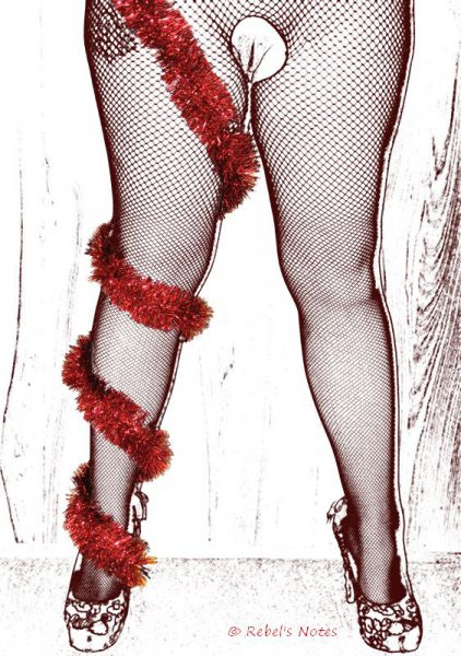 An image of my legs, and one leg has red tinsel wrapped around it.
