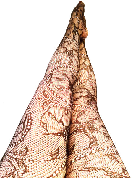 Legs in net tights against wall