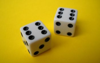 two dice showing six on a yellow background