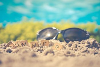 image with blue sky, the beach, sunglasses and the word summer