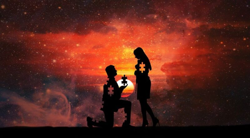 An image with a man on his knees in front of a woman, holding a puzzle piece which should fit the puzzle piece missing from her heart. I chose this image to go with the title missed connections.