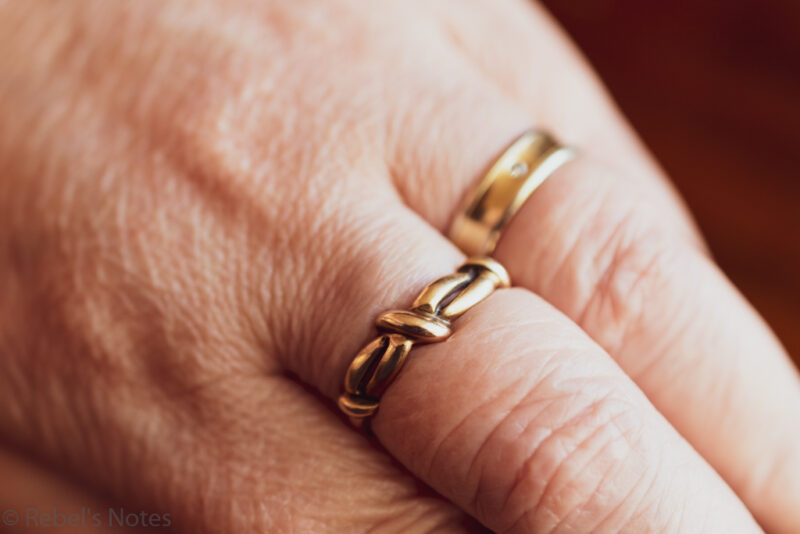 An image showing mom's ring that I wear on my middle finger, next to my wedding band. Not a family heirloom, but very important to me.