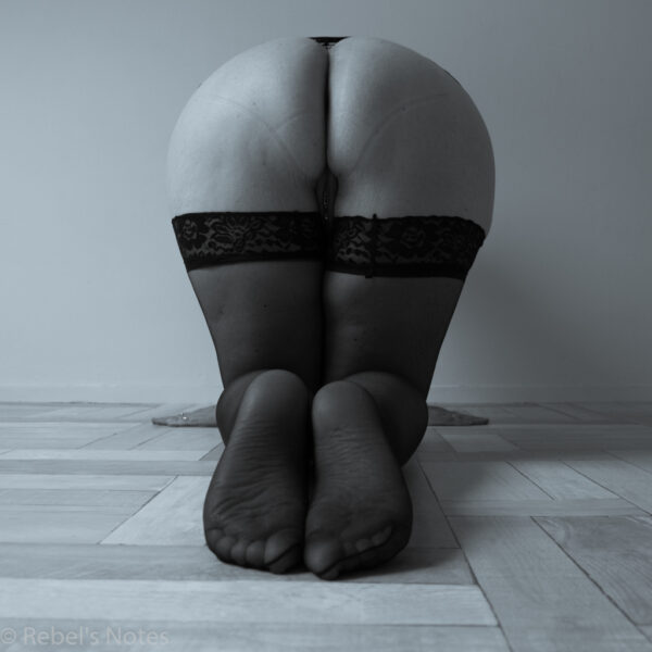 An image of me on my knees, my naked bottom to the camera, trying to attempt symmetry in my image.