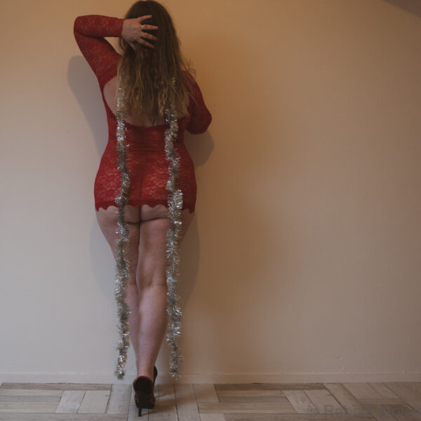 A Christmas dress up, entirely minimalist in my short red lace dress, high heels and some tinsel.