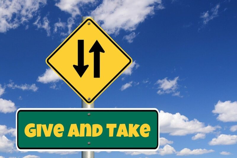An image with a road sign that says 'give and take', to go with my post about giving to others.