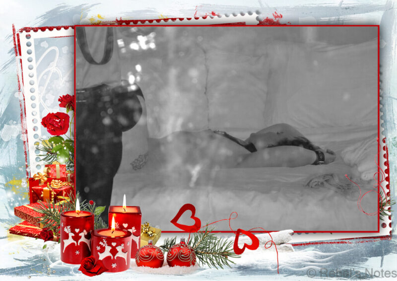 An image to go with my festive fantasy, showing me on a hotel bed, naked and Master T fully clothed, both in the reflection of a mirror.