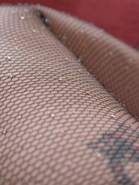 Net stockings with sparkly stones on them, perfect to be used as Christmas stockings.