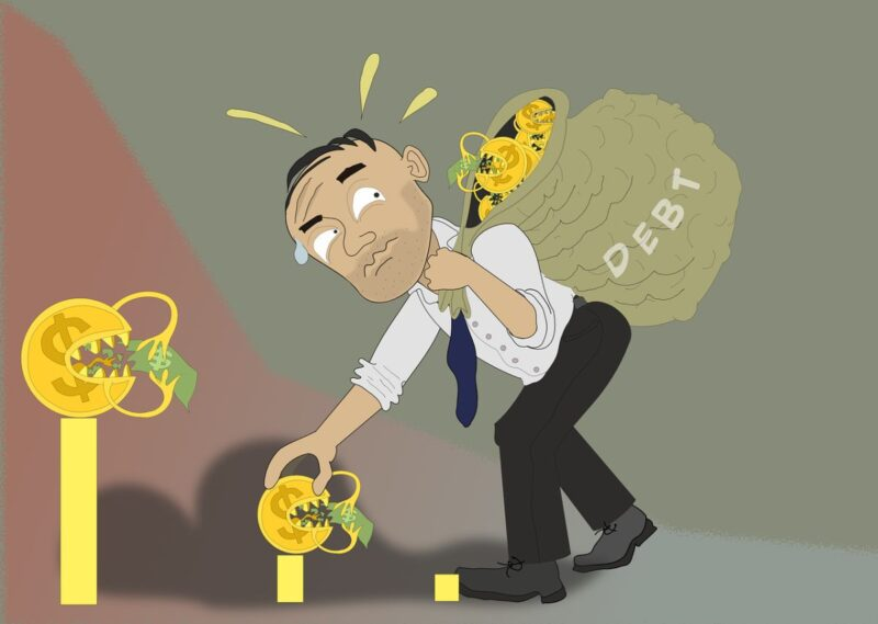 A drawing of a man carrying a bag of money and on the bag is written 'debt'.