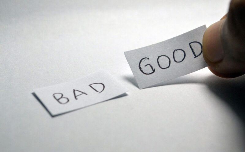 An image with two pieces of paper, and the words 'bad' and 'good' written on it, to go with the post about bad habits.