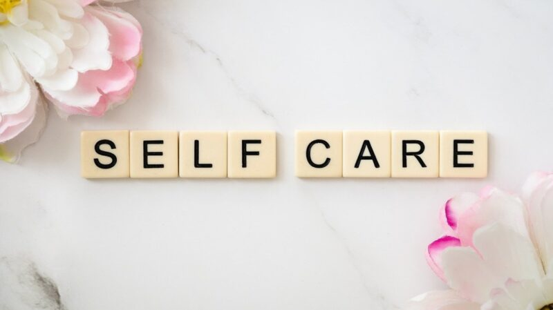 An image where the word self-care is spelled with Scrabble letters.