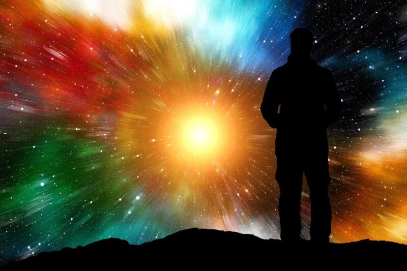 An image showing the silhouette of a man looking at a rainbow explosion of stars. The colors made me think of being impulsive.