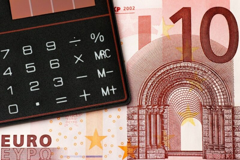 An image showing a calculator and a ten euro bill to go with the post about having a budget.