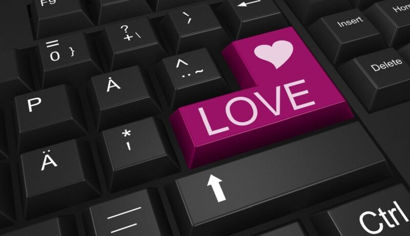An image of a keyboard with a purple enter key, saying 'love', to go with my story Jennifer and Amber.
