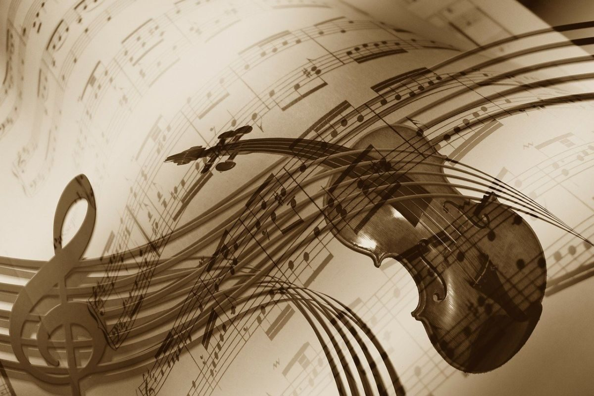 An image of sheet music with a musical note and a violin, to go with my post about a tribute to mom for my own taste in music.