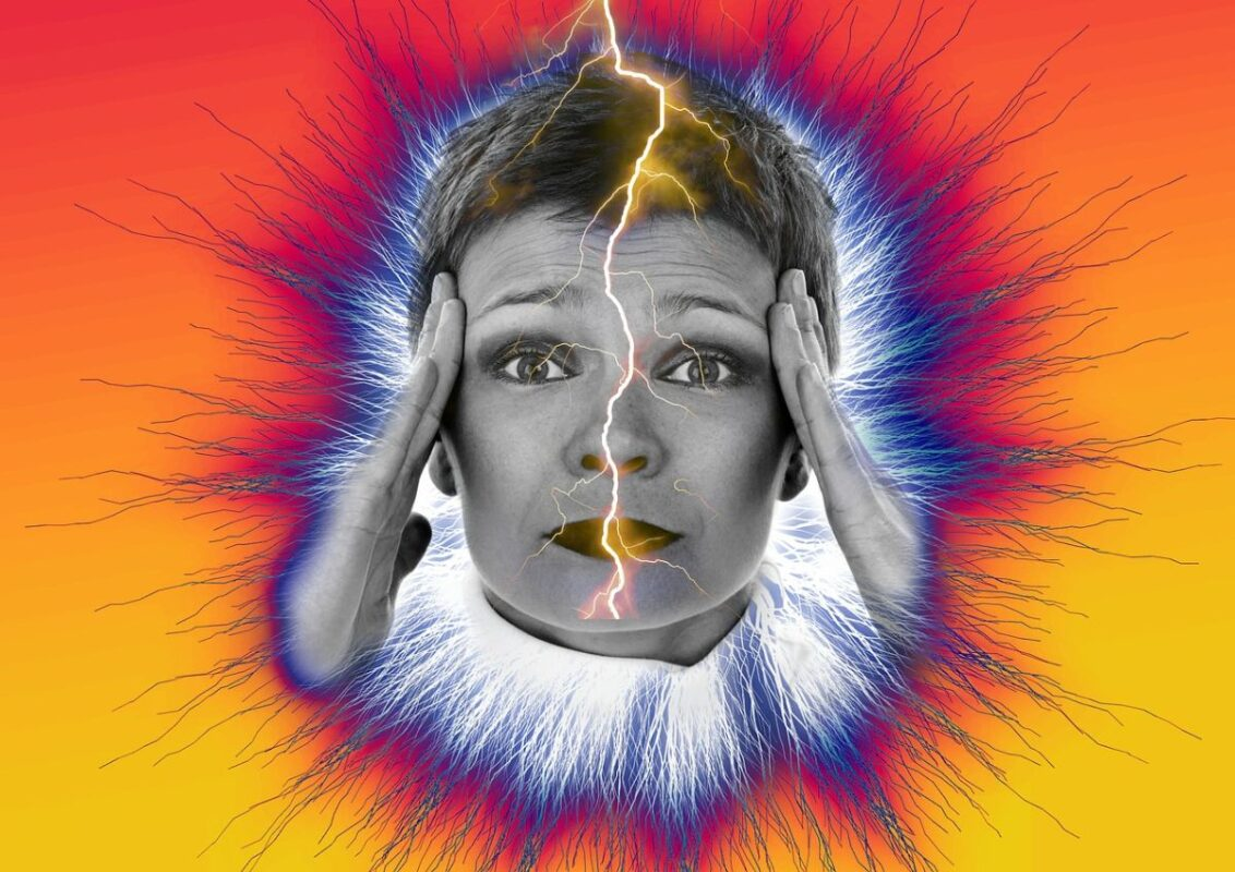An image of a woman holding her head and a lightning bold in front of her face to go with my post about headaches.