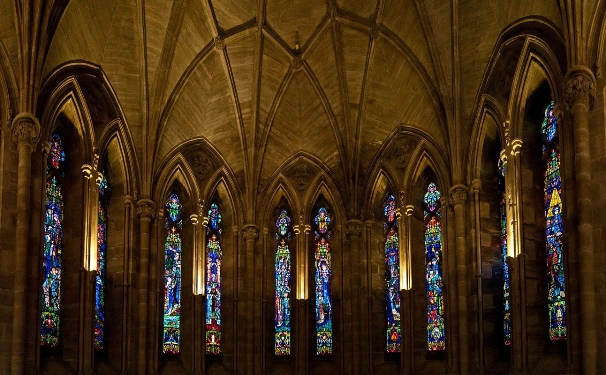 Image of the inside of a church with stained glass windows, to go with my final 'priest story', where we see Priest Peter is no saint.