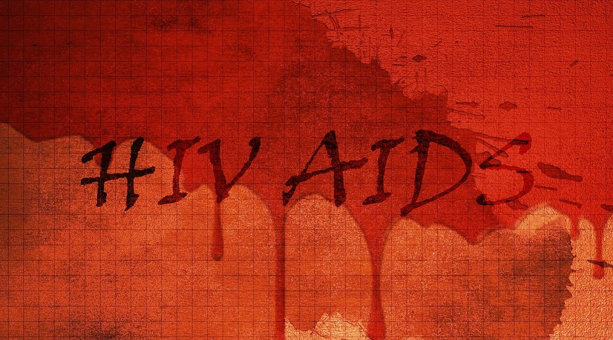 An image with a red background and blood seeing to run down the wall, with the words HIV AIDS written in the blood to go with my series about my friend, and the last thirteen years of his life.