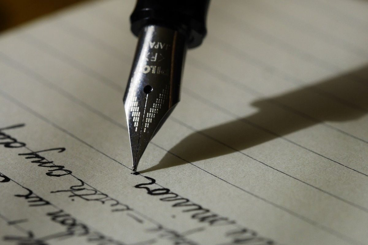 An image of a fountain pen writing words on a piece of paper, to go with my post about keeping a 'dear diary'.