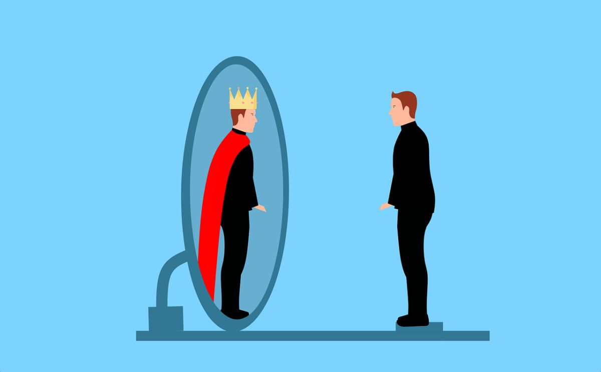 An image of a man looking in a mirror and seeing a king, to go with my post about the narcissists in my life.